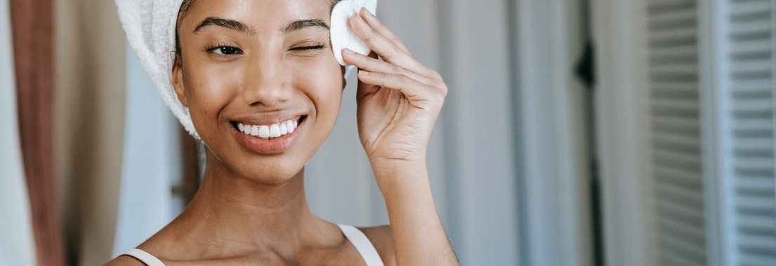 Woman doing her skin care routine What Products Should Everyone Have in Their Skincare Routine?