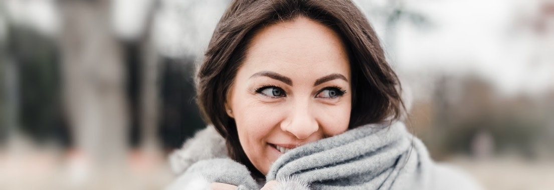 Woman standing in winter with rosacea How to Treat Rosacea in the Cold Winter Months