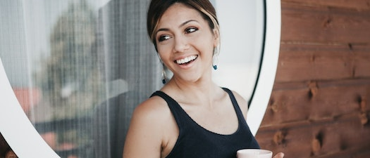 Woman smiling with Botox How to Use Botox for Wrinkle Prevention