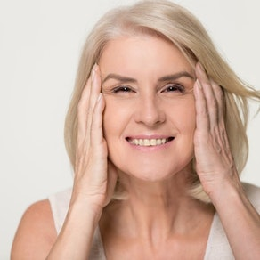 Woman analyzing her facial skin How to Know Whether You're Aging Well or Not