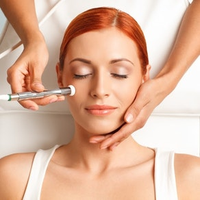 Woman having microdermabrasion treatment What Is the Best Time of Year for Microdermabrasion?