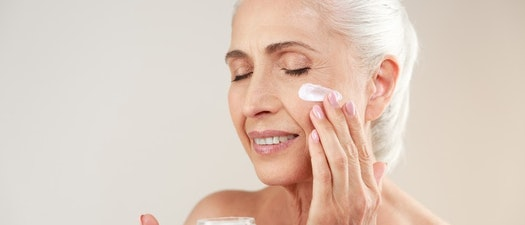 Woman applying cream to wrinkled skin Do Creams Really Reduce Wrinkles? Ask the Experts