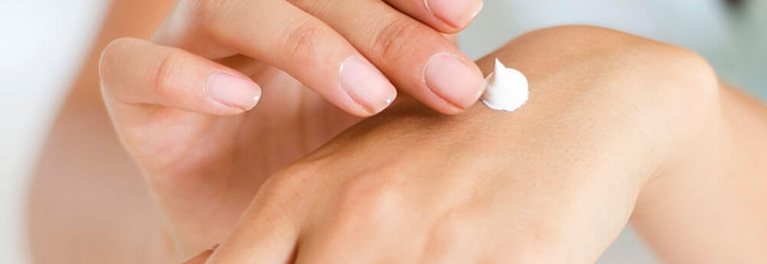 Applying cream to dry skin Winter Skin Care: Treating Dry and Chapped Skin