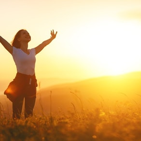 Woman in a field in the spring Springtime and Rashes: How to Enjoy the Sun Without the Rash