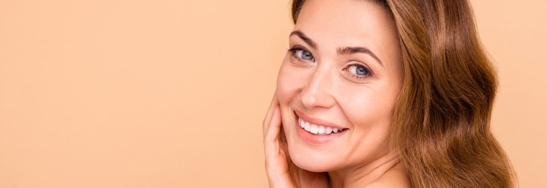 Woman with clear skin Why Hyaluronic Acid Is Your Best Friend