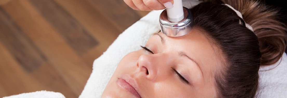 Woman having laser skin therapy What You Need to Know About Light Therapy and Your Skin Condition