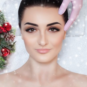Woman receiving a facial treatment De-Stress Pre-Holiday with a Facial That Helps You Relax
