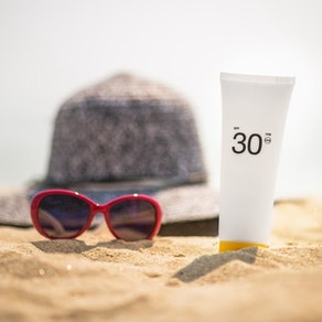 Sunscreen on a beach Remember Your Sunscreen This Spring Break: Here's Why