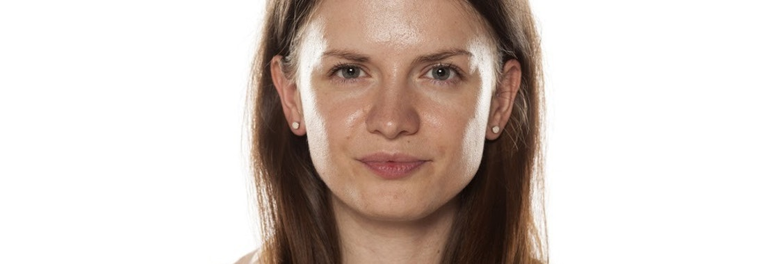 Woman with oily skin Top Tips for Managing Oily Skin Year-Round