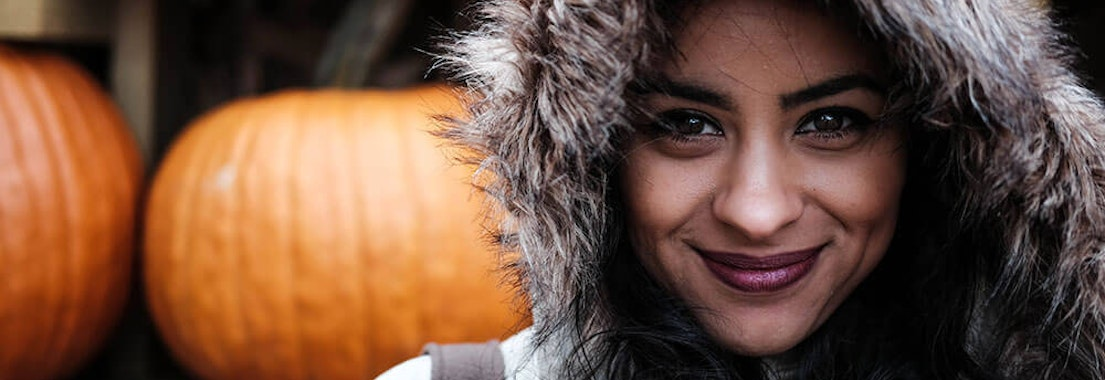 Woman smiling in winter weather Is Your Skin Ready for Cool Weather?