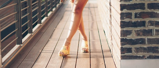 Woman standing on a bridge Cocktail Party Coming Up? How To Get Rid of Unwanted Hair