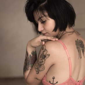 Woman with tattoo laser removal Laser Therapy: From Stretch Marks to Tattoo Removal