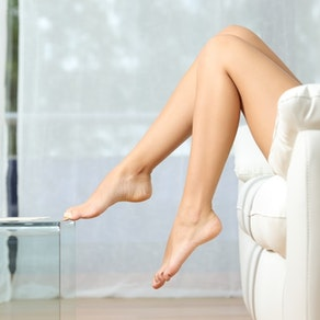 Woman sitting on couch after Gentlemax Pro treatment The Many Pros of Gentlemax Pro