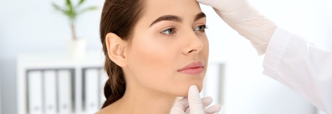 Woman receiving skin consultation from a dermatologist Where to Begin? Come in for a Skin Consultation and See