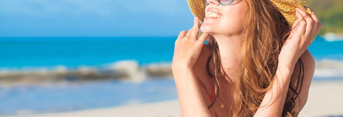 Woman laying in the beach When to Treat Basal Cell Carcinoma with Mohs Surgery