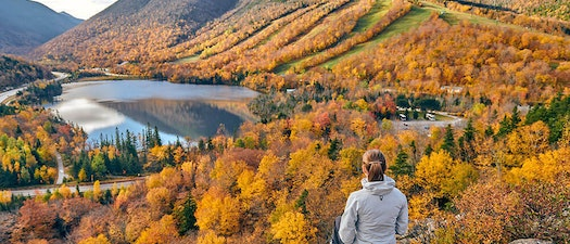 Woman on a mountain in autumn Seasonal Allergies and Your Skin: What to Expect