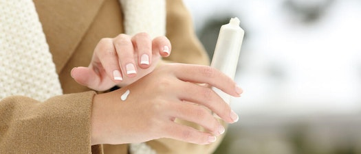 Woman applying cream Winter is Here: Learn How to Care for Dry and Chapped Skin