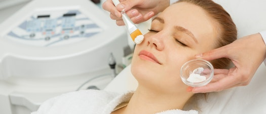 Woman receiving facial treatment for acne Enjoy a Fall Acne Facial and Look Your Best This Season