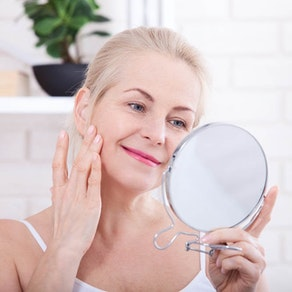 Northeast Dermatology Associates woman applying anti-aging treatment Our Best Advice for Slowing Your Skin's Aging Process