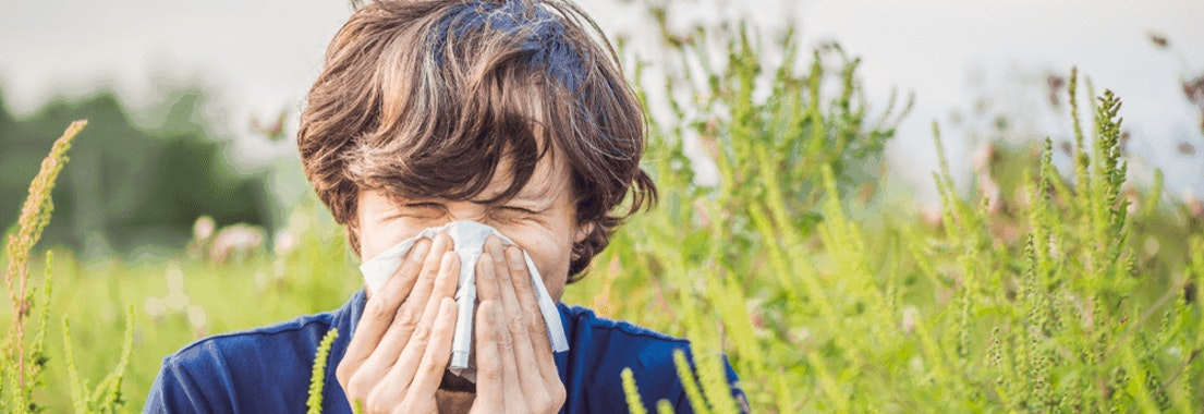 Boy with fall allergies blowing his nose Reduce Skin Irritation from Fall Allergies