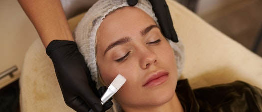 Woman having chemical peel treatment Why Summer Is a Great Time for a Chemical Peel