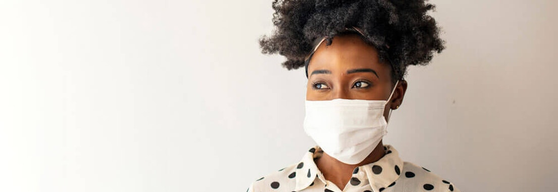 Woman wearing a mask Don't Let Face Masks/PPE Irritate Your Skin