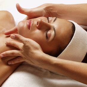 Woman receiving a facial treatment De-Stress Pre-Holiday with These Relaxing Facials