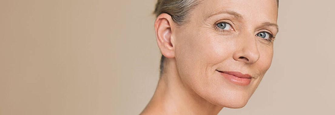 Woman feeling her shoulder skin The Complete Guide to Hyaluronic Acid