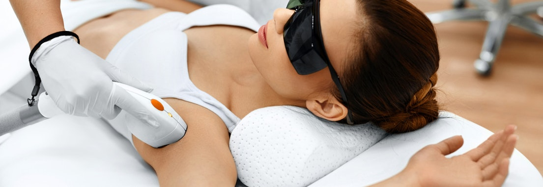 Woman having laser hair removal on armpit Why a Hair Removal Treatment Is Just What You Need This Spring