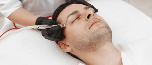 Man having microdermabrasion treatment What Is the Best Time of Year for Microdermabrasion?