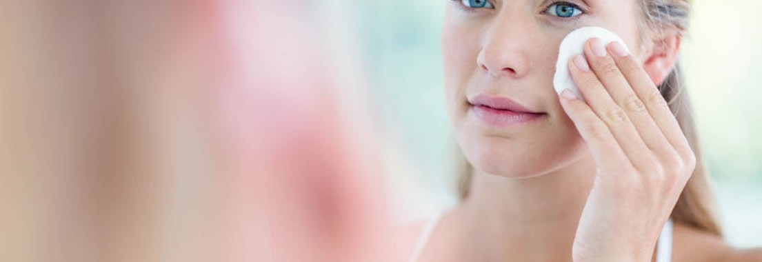 Northeast Dermatology Associates woman applying skin products Sleep Your Way to Great Skin with these Nighttime Beauty Rituals