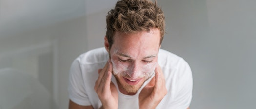 Man applying facial moisturizer How to Keep My Skin Clear and Moisturized