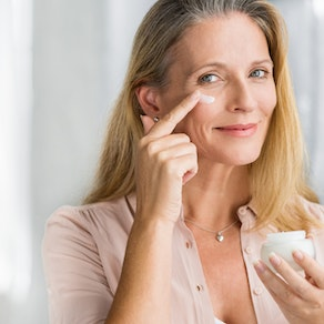 Woman applying a cream to wrinkles Do Creams Really Reduce Wrinkles? Ask the Experts