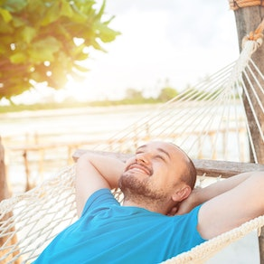 Man laying in a hammock in the spring Springtime and Rashes. How to Enjoy the Sun Without the Rash