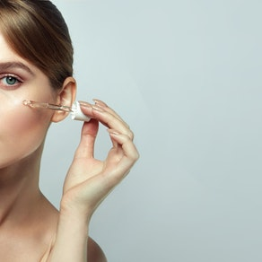 Woman having vitamins applied to her face Best Vitamins for the Skin