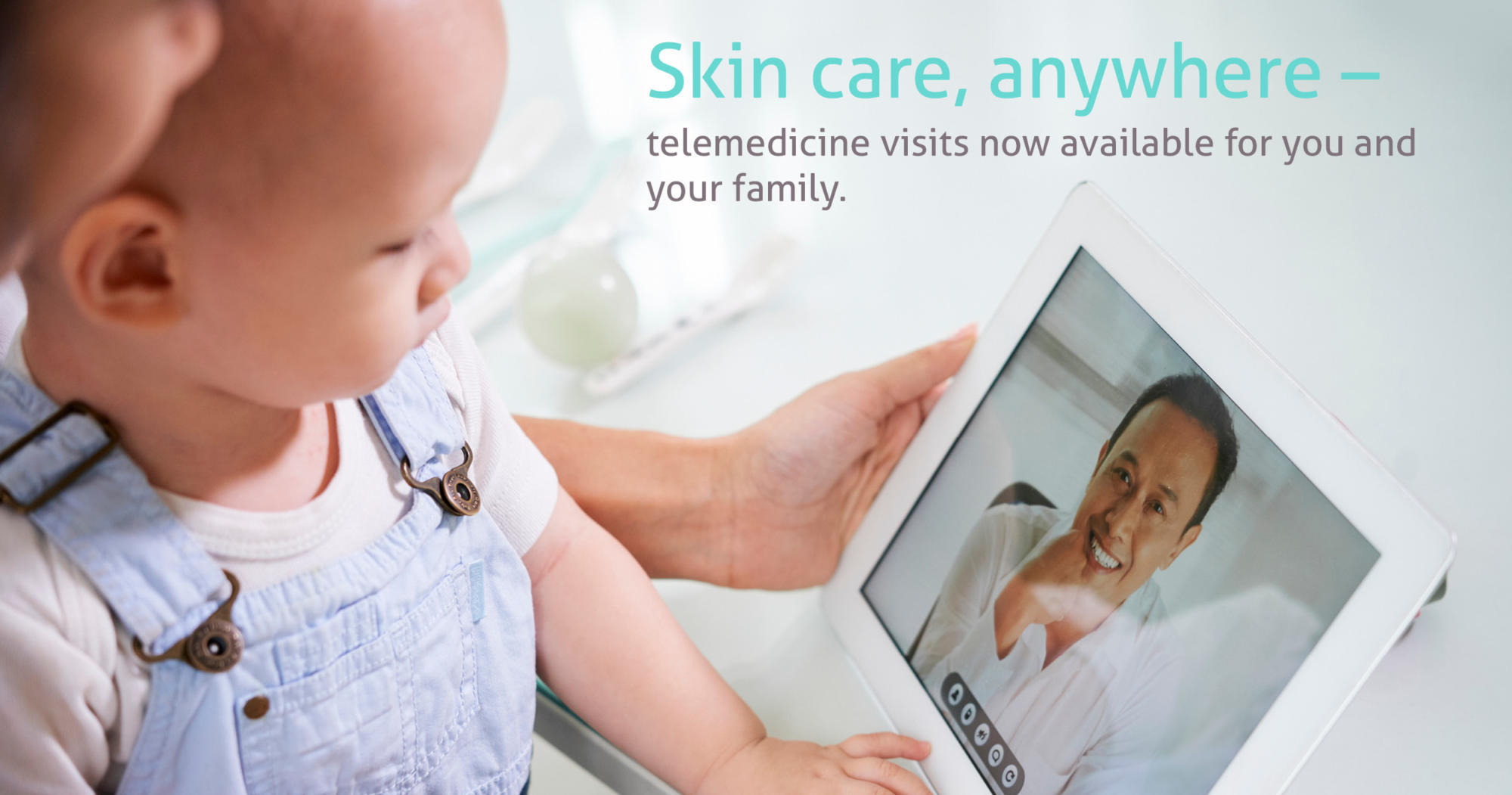 Parent and baby doing a telemedicine appointment on an iPad