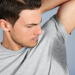 Man with hyperhidrosis in his armpits 5 Ways to Handle Hyperhidrosis in the Winter