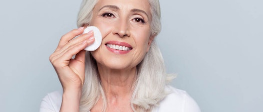 Woman applying anti-aging makeup 5 Surprising Makeup Tips for Aging Skin