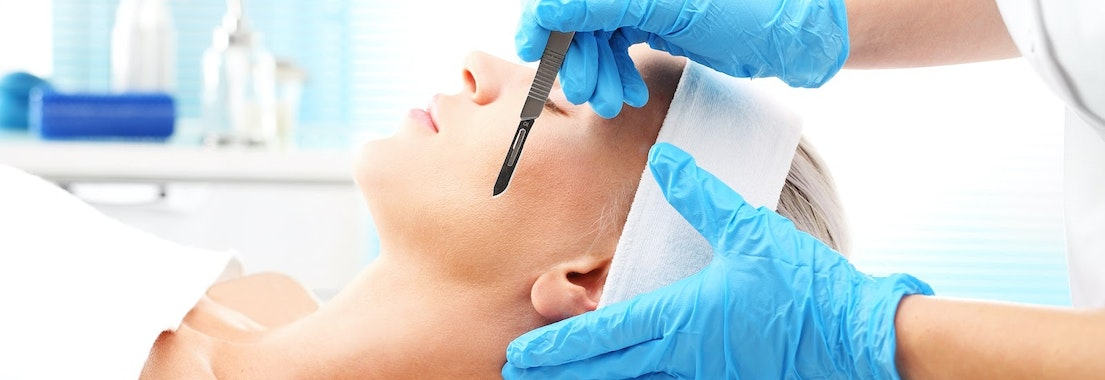 Woman having dermaplaning treatment 7 Ways Dermaplaning Makes Your Skin Look and Feel Better