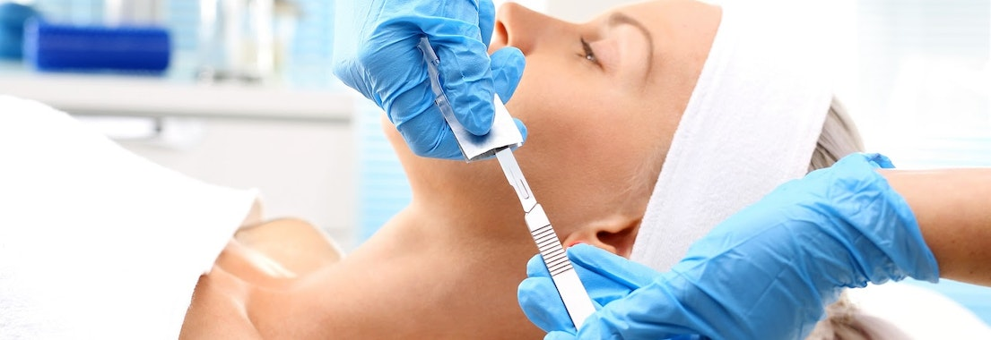 Woman having dermaplaning treatment Acne as a Teen? Try Dermaplaning