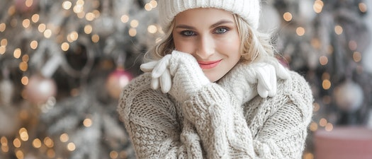 Woman smiling after facial treatments Be Confident at Your Holiday Party with These Skin Care Treatments