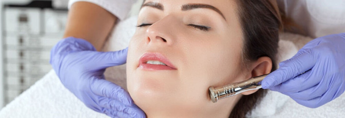 Doctor treating patient's acne Consider Adding These Cosmetic Services to Your Acne Treatment