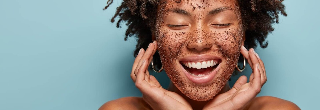 Woman exfoliating her face Is Exfoliating Really Good for Your Skin and How Often Should You Do It?