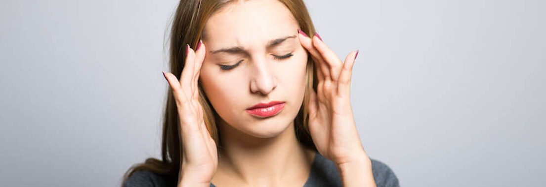 Girl stressed with broken out skin How Stress Can Affect Your Skin