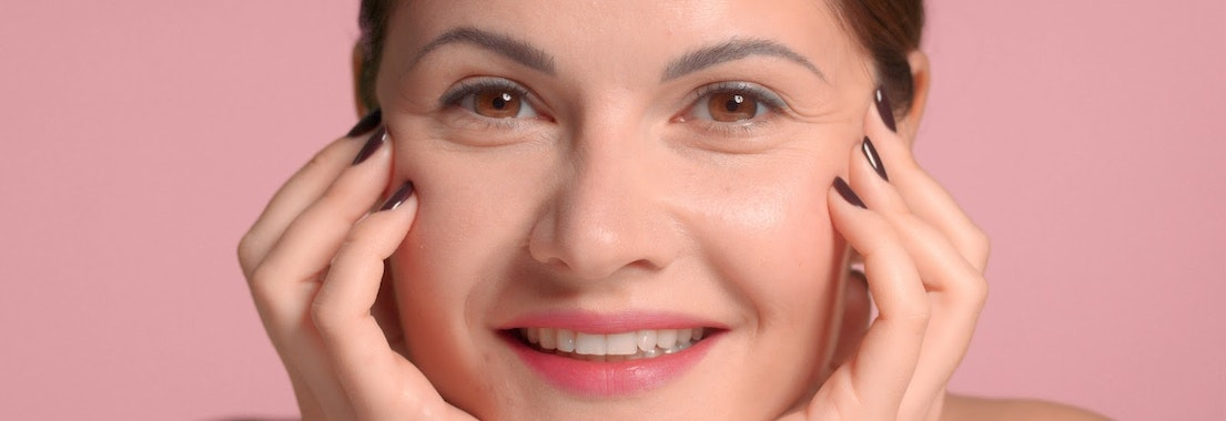 Woman smiling without wrinkles How to Reduce Wrinkles After They've Appeared
