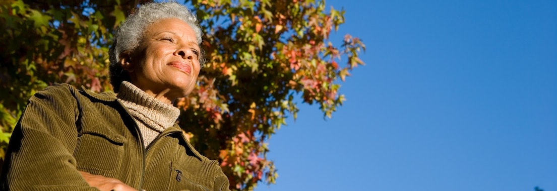 Woman outside in the fall Reduce Skin Irritation from Fall Allergies