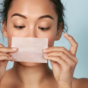 Woman treating oily skin Top Tips for Managing Oily Skin Year-Round