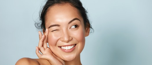 Woman with clear skin smiling What Facials Can Do For Your Skin After a Hot Summer