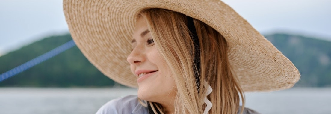 Woman smiling with rosacea How to Avoid Rosacea Flare Ups This Summer