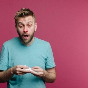 Man sneezing from fall allergies Reduce Skin Irritation from Fall Allergies